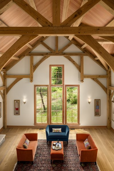This view from the loft of this renovated barn by OakBridge Timber Framing highlights the elegant combination of old and new elements.