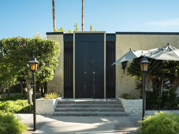 The Hollywood Regency–style home sits almost exactly as Elrod left it. The oversized doors feature antique Moroccan brass door pulls made from a four-poster bed.