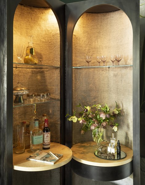 """We were inspired by a vintage piece of furniture and loved the idea of reinterpreting it as bar and vanity combination,"