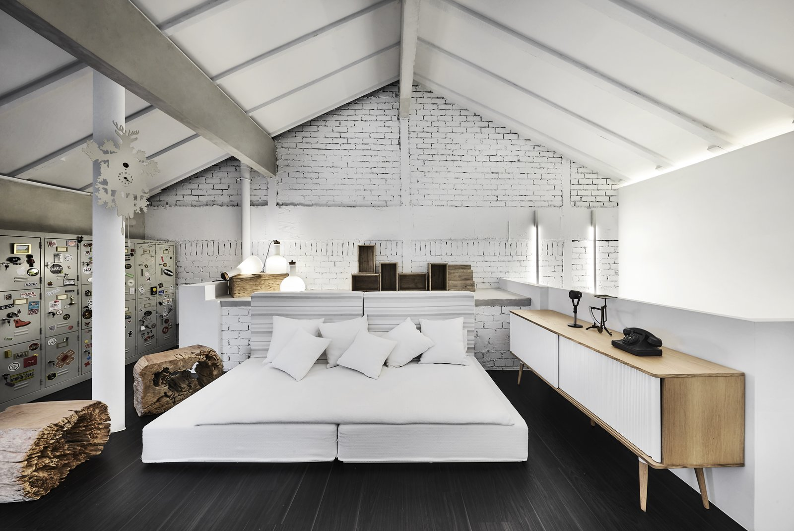 The insertion of an attic makes the most of the apartment's tall ceilings as well as provides ample space for the family.