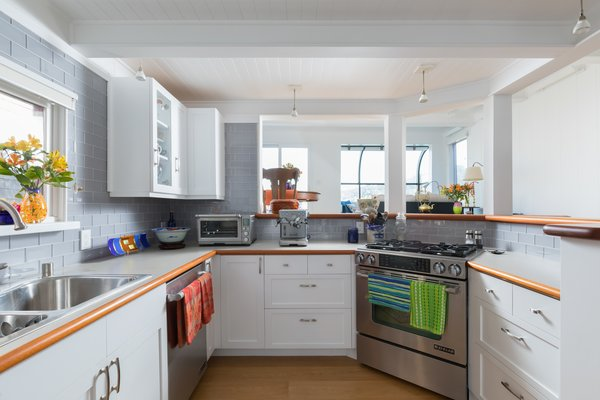Gray subway tiles add a muted color tone in the renovated kitchen, which features all new appliances, as well as ample countertop space and cabinetry.